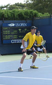 Grand Slam champions Mike and Bob Bryan during first round doubles match at US Open 2013 — Stock Photo