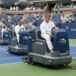 US Open cleaning crew drying tennis court after rain delay at Arthur Ashe Stadium — Stock Photo #30780273