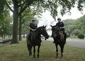 NYPD police officers on horseback ready to protect public at Billie Jean King National Tennis Center during US Open 2013 — Stock Photo