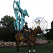 Stock Photo: NYPD police officer on horseback ready to protect public at Billie JeKing National Tennis Center during US Open 2013