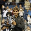 Stock Photo: US Open 2013 champion Rafael Nadal holding US Open trophy during trophy presentation