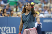 Sixteen times Grand Slam champion Serena Williams during her first round doubles match with teammate Venus Williams at US Open 2013 — Stock Photo