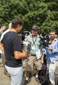 US Open 2013 champion Rafael Nadal with US Open trophy surrounded by journalists during interview in Central Park — Stock Photo