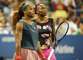 Grand Slam champions Serena Williams and Venus Williams during their first round doubles match at US Open 2013 — Stock Photo