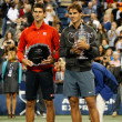 Постер, плакат: US Open 2013 champion Rafael Nadal and finalist Novak Djokovic during trophy presentation after final match