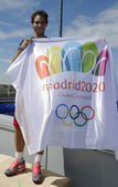 Thirteen times Grand Slam champion Rafael Nadal holding Madrid 2020 Summer Olympic flag — Stock Photo