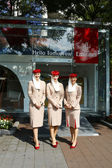Emirates Airline flight attendants at the Emirates Airline booth at the Billie Jean King National Tennis Center during US Open 2013 — Stock Photo