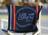 US Open 2013 official towel on player chair at the Arthur Ashe Stadium — Stock Photo