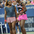 Grand Slam champions SerenWilliams and Venus Williams during first round doubles match at US Open 2013 — Foto de stock #32164223