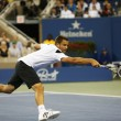 Professional tennis player Mikhail Youzhny during  quarterfinal match at US Open 2013 against  Novak Djokovic — Stock Photo