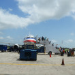 Постер, плакат: Passengers disembarking American Airlines plane landed at Philip Goldson Airport in Belize