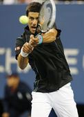 Professional tennis player Novak Djokovic during quarterfinal match at US Open 2013 against Mikhail Youzhny — Stock Photo