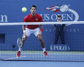 Professional tennis player Novak Djokovic during fourth round match at US Open 2013 against Marcel Granollers — Stock Photo