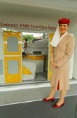 Emirates Airline flight attendant at the Emirates Airline booth at the Billie Jean King National Tennis Center during US Open 2013 — Stock Photo