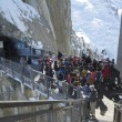Tourists arrived by cable car at the central footbridge at the Aiguille du Midi — Stock Photo #33679489