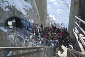 Tourists arrived by cable car at the central footbridge at the Aiguille du Midi — Stock Photo
