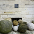 Ancient cannon balls on display in Papal Palace in Avignon, France — Stock Photo #34287761