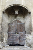 Main entry wooden gate of the Papal Palace in Avignon,France — Stock Photo