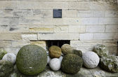 Ancient cannon balls on display in Papal Palace in Avignon, France — Stock Photo