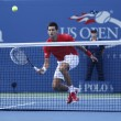 Постер, плакат: Professional tennis player Novak Djokovic during fourth round match at US Open 2013