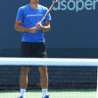 Stock Photo: Professional tennis player Alexandr Dolgopolov from Ukraine practices for US Open 2013