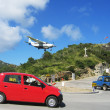 Stock Photo: Risky plane landing at St Barts airport