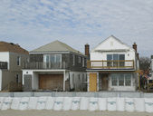 Damaged beach houses in devastated area one year after Hurricane Sandy — Stock Photo