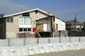 Damaged beach house in devastated area one year after Hurricane Sandy — Stock Photo