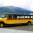 Stock Photo: Skagway AlaskStreet Car Tour bus at Skagway harbor in Alaska