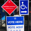 Stock Photo: Signs at voting site in New York