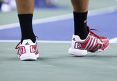 Six times Grand Slam champion Novak Djokovic wears custom Adidas tennis shoes during match at US Open 2013 — Stock Photo