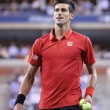 Постер, плакат: Six times Grand Slam champion Novak Djokovic during first round singles match at US Open 2013
