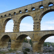 The Pont du Gard, ancient Roman aqueduct bridge build in the 1st century AD in southern France — Stock Photo