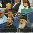 Serbian Orthodox Church Patriarch Irinej Gavrilovic at Billie Jean King National Tennis Center during quarterfinal match at US Open 2013 with Novak Djokovic — Stock Photo