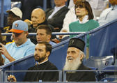 Serbian Orthodox Church Patriarch Irinej Gavrilovic at Billie Jean King National Tennis Center during quarterfinal match at US Open 2013 with Novak Djokovic — Stock Photo