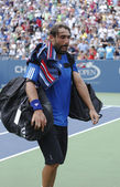 Professional tennis player Marcos Baghdatis from Cyprus leaving Louis Armstrong stadium after third round match loss at US Open 2013 — Stock Photo