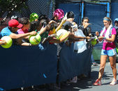 Two times Grand Slam champion Victoria Azarenka signing autographs after practice for US Open 2013 — Stock Photo