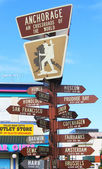 Anchorage, Alaska air crossroads of the world signpost — Stock Photo