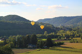 Hot air balloons flying over Dordogne in southwestern France — Stock Photo