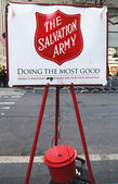 Salvation Army red kettle for collections in midtown Manhattan — Stock Photo