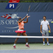 Sixteen times Grand Slam champion SerenWilliams practices for US Open 2013 with her coach Patrick Mouratoglou — Stock Photo #37853957