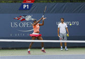 Sixteen times Grand Slam champion Serena Williams practices for US Open 2013 with her coach Patrick Mouratoglou — Stock Photo