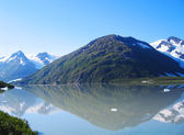 Mountains reflection over a lake in Alaska — Stock Photo