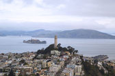 Areal view of Coit Tower and streets of San Francisco in the front of Alcatraz island in San Francisco Bay — Stock Photo