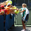 Professional tennis player AgnieszkRadwansksigning autographs after practice for US Open 2013 at Billie JeKing National Tennis Center — Stock Photo #37992725