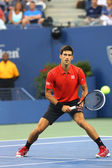 Professional tennis player Novak Djokovic during first round match at US Open 2013 against Ricardas Berankis at Billie Jean King National Tennis Center — Stock Photo