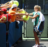Professional tennis player Agnieszka Radwanska signing autographs after practice for US Open 2013 at Billie Jean King National Tennis Center — Stock Photo