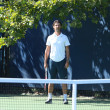 Stock Photo: Coach Patrick Mouratoglou supervises sixteen times Grand Slam champion SerenWilliams during practice for US Open 2013 at Billie JeKing National Tennis Center
