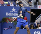 Seventeen times Grand Slam champion Roger Federer during third round match at US Open 2013 against Adrian Mannarino at Billie Jean King National Tennis Center — Stock Photo