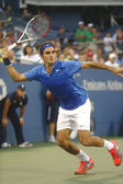 Seventeen times Grand Slam champion Roger Federer during fourth round match at US Open 2013 against Tommy Robredo at Billie Jean King National Tennis Center — Stock Photo